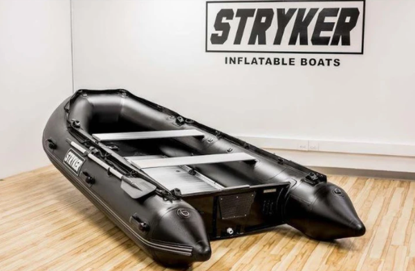 A very large grey and black inflatable Stryker boat.