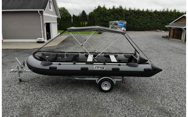 A large inflatable boat loaded on a trailer.