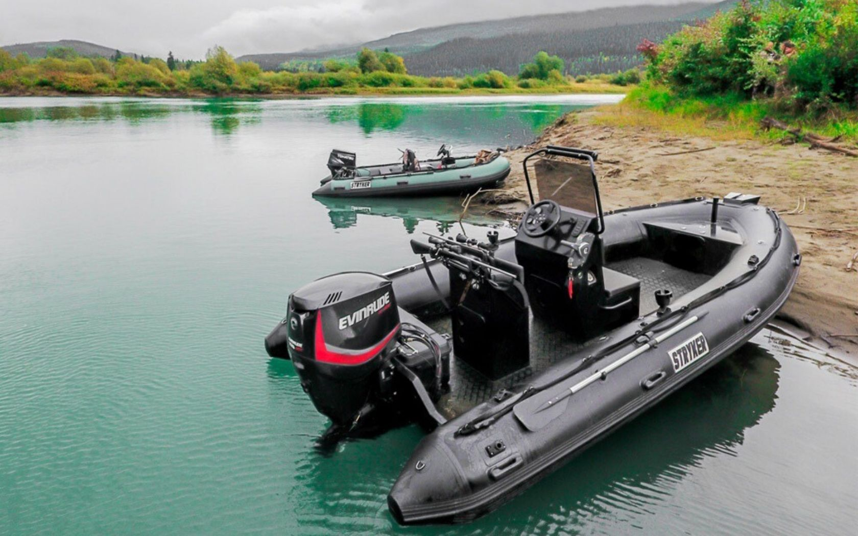 Two Stryker Inflatable Boats floating on a gorgeous lake.