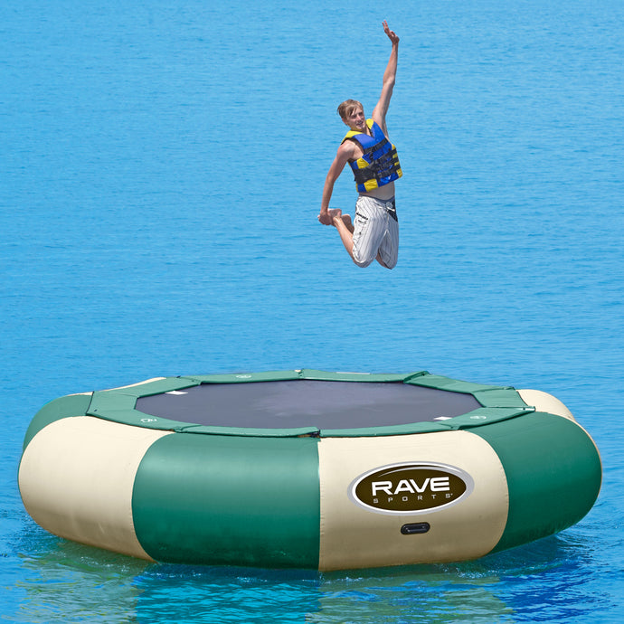 A man jumping in Rave Sports Aqua Jump 150 Northwoods Water Trampoline 00151