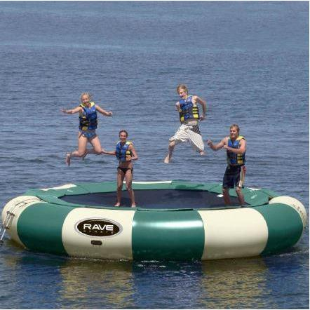 4 people enjoying the Rave Sports Aqua Jump 200 Northwoods Water Trampoline 00201