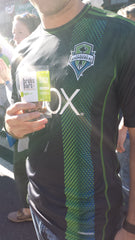 Sean holding a brüks bar during the Sounders game.