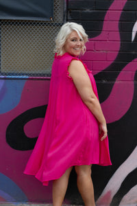 Our beautiful Isabella Dress is  PERFECT dress for those HOT summer days! She's light & flowy and gorgeous to wear!  Details:  Lightweight dress  Thick singlet sleeves  Generous sizing  Bump friendly  Cute frill detailing on sleeves, cross the bust & neckline Rounded neckline  Hi-low neckline Colour:  Fuchsia pink Sizing:  Tara wears a 14, generous sizing Fabric:  100% Viscose  Measurements:   Size 14 Length Front: 94cm Length Back: 104cm Bust: 61cm Arm Seam: 28cm