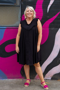 Our beautiful Isabella Dress is PERFECT dress for those HOT summer days! She's light & flowy and gorgeous to wear!  Details:  Lightweight dress  Thick singlet sleeves  Generous sizing  Bump friendly  Cute frill detailing on sleeves, cross the bust & neckline Rounded neckline  Hi-low neckline Pockets Colour:  Black Sizing:  Tara wears a 14, generous sizing Fabric:  100% Viscose  Measurements:   Size 14 Length Front: 94cm Length Back: 104cm Bust: 61cm Arm Seam: 28cm