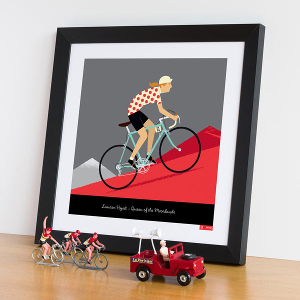 Framed example of Queen of the Mountains personalised print with Celeste bike colour option.