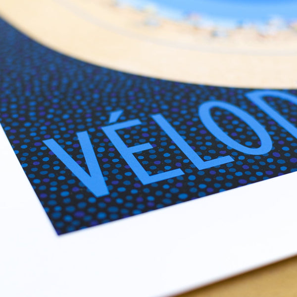 Close up detail of velodrome cycling print text.