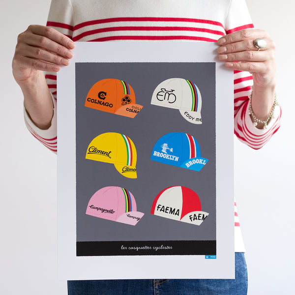 Person holding unframed Cycling Caps print, size: 30 x 40 cm.