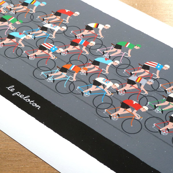 Detail of cycling print featuring riders racing in the World Road Race Championship.