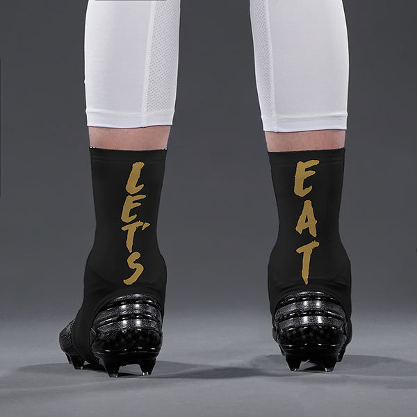 e75a0b65edc Let s Eat Black Gold Spats   Cleat Covers