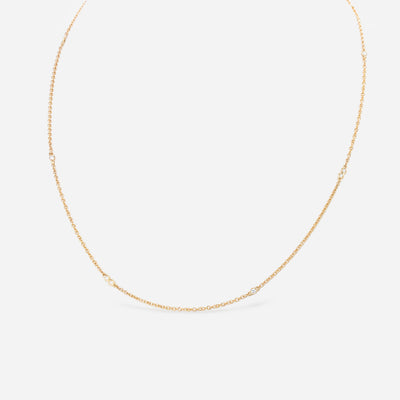 Kate & Mimi 18K yellow gold diamond necklace with alternating single diamond set in bezel setting and double diamond bezels