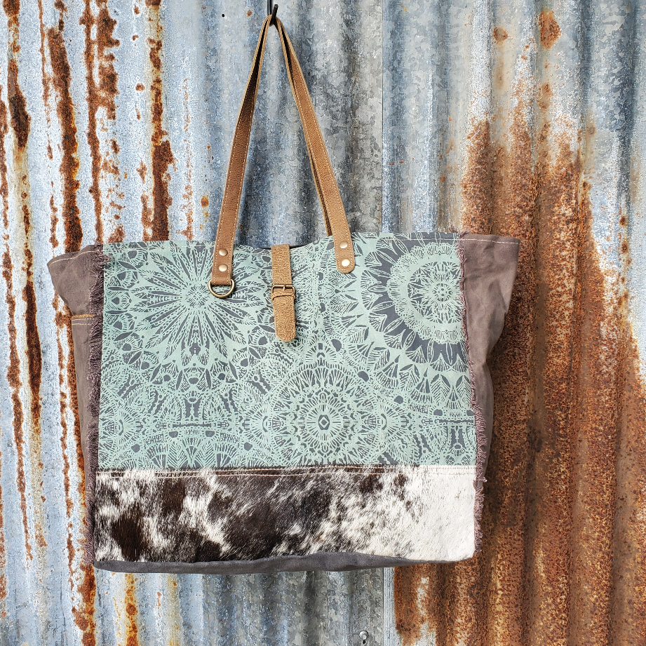 Turquoise and Cowhide Weekender Front