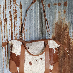 Over Size Brown and White Cowhide Duffel Back