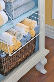 bathroom, organizing bathroom, bathroom towels, folded towels, organizing