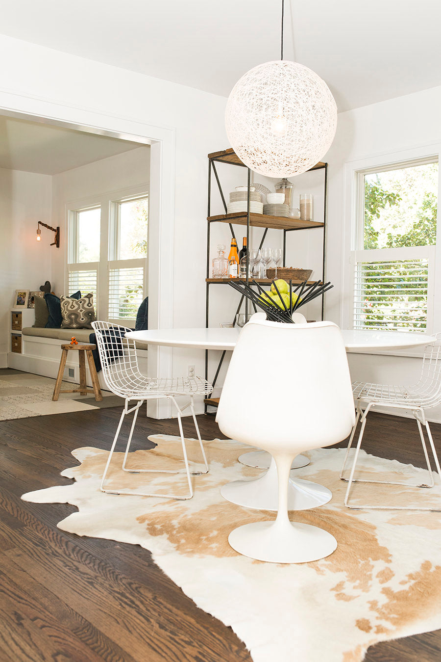 Bertoia Side Chairs, Moooi-Random Light, Modern Dining Room, White Dining Room, Lauren Combs house, Cow Hide Rug,  Knoll-Saarinen Round Dining Table, Knoll-Saarinen Armless Tulip Chairs,