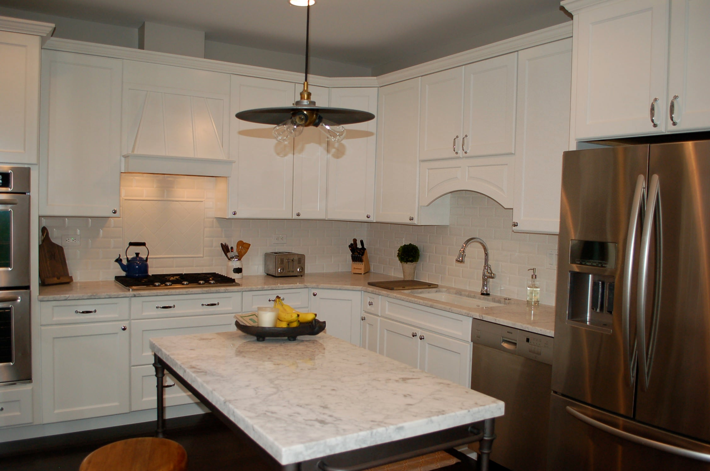 white kitchen, carrara counters, marble counters, kitchen lighting