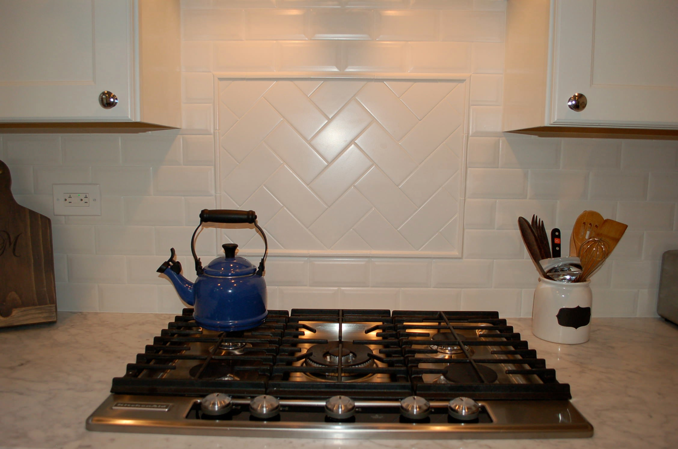 herringbone tile, white kitchen tile, subway tile, ann sacks, wooden hood
