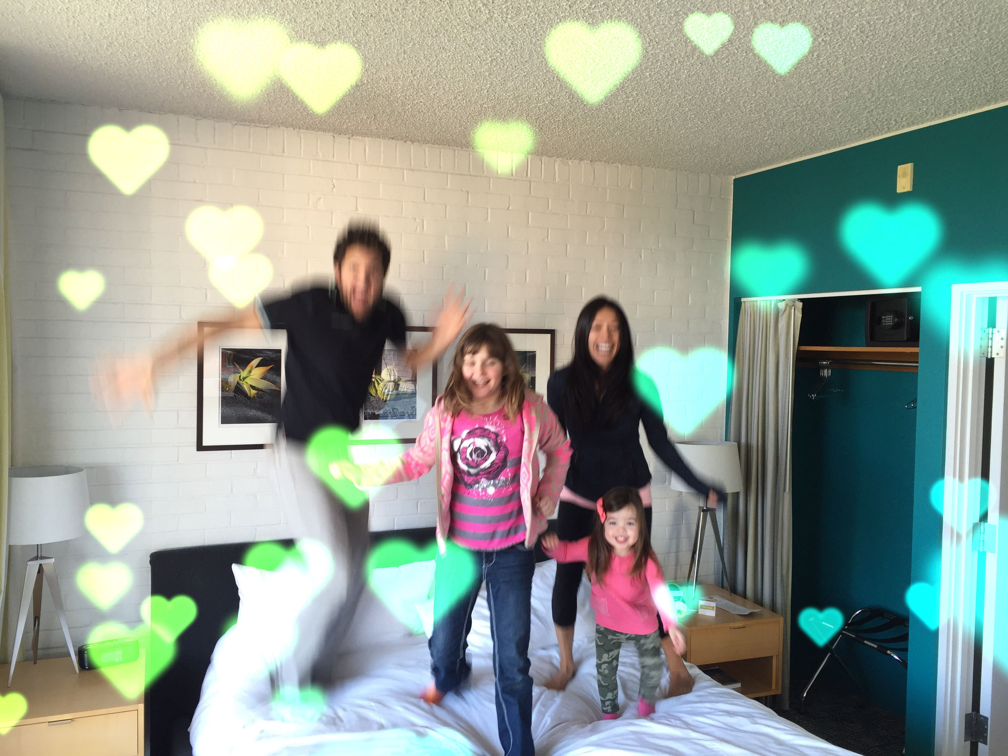 Mika Perry, Russ Perry, Family, Valentine, jumping on the bed, cute family, hotel, family photo, professional organizer, Scottsdale, Phonenix