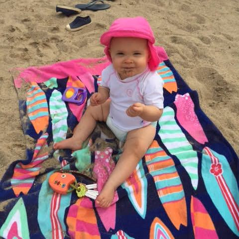 Lauren Combs, Michigan, Perry Combs, beach towel, surfboards, baby, baby girl, beach hat, sand,