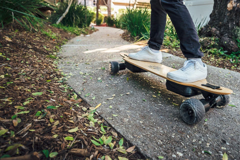 Omen Swarm longboard trail riding with electric skateboard conversion kits on front and back wheels for 4WD longboarding