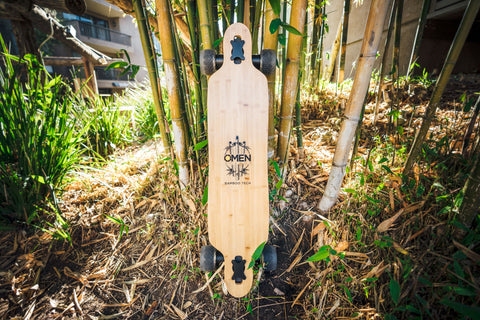 Top of Omen Swarm longboard deck with bamboo