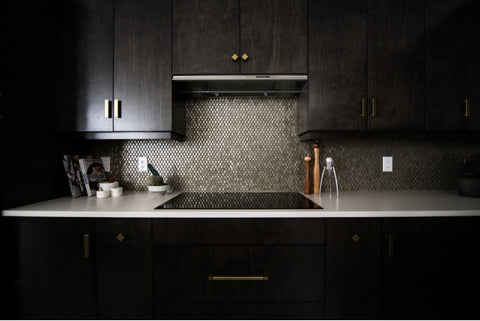 a kitchen counter and cabinets