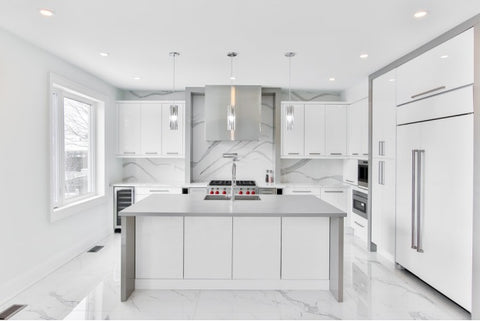 A kitchen with new, stainless steel handles