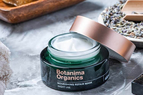 Botanima-Organics-Skincare-CBD-Nourishing-Repair-Mask-Open-Green-Jar-on-Marble-Surface