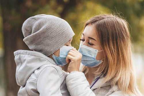 girl-with-child-stands-road-protective-medical-mask-coronovirus