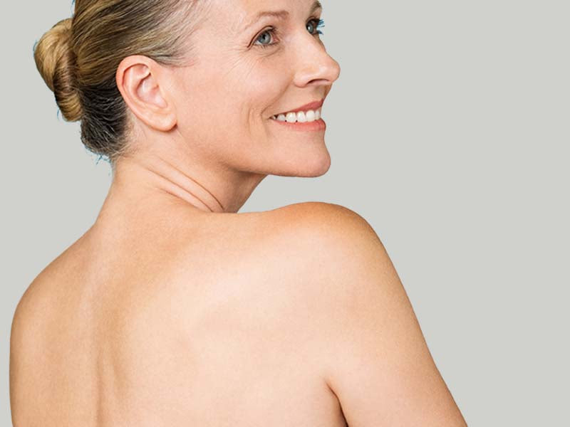 A-Blond-Middle-Aged-Woman-With-A-Bare-Back