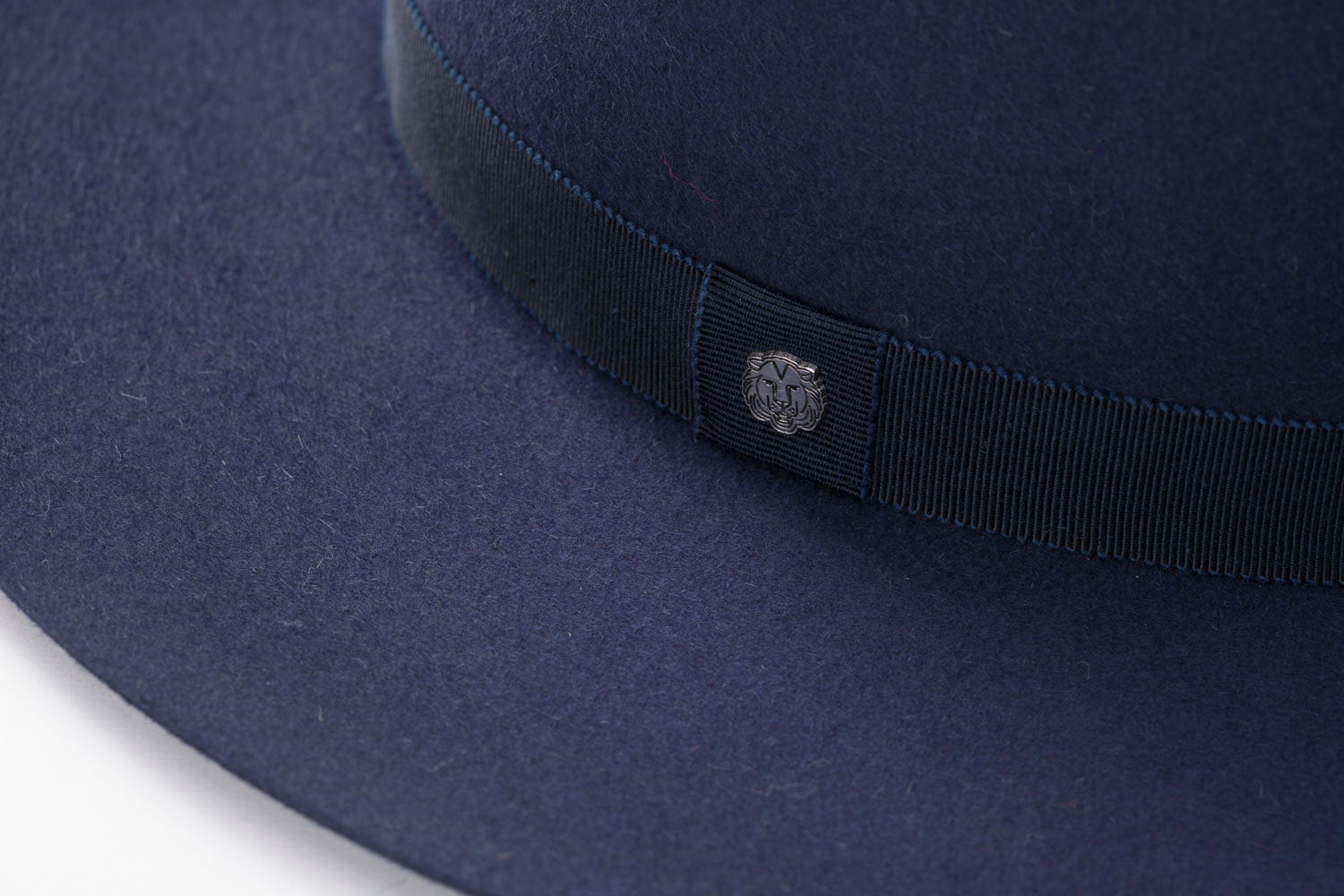 TAU Amsterdam hat navy fedora kalap fur felt decorated with tonal petersham and lion logo designed in Budapest detail picture unisex accessory