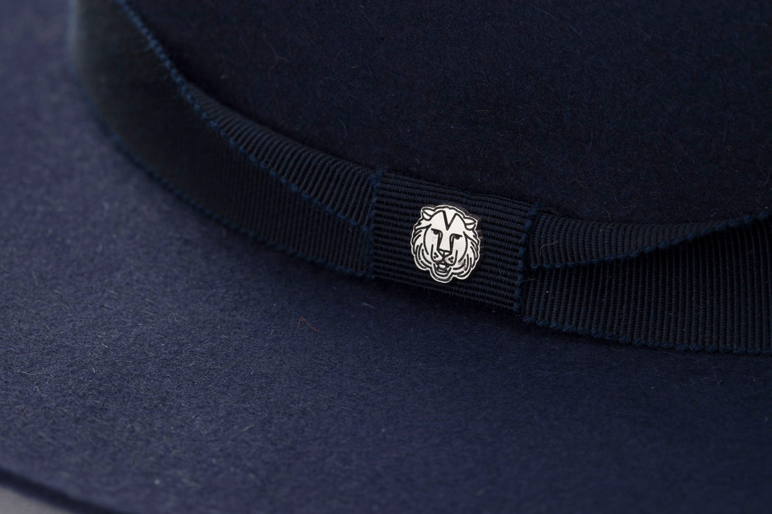 TAU Dallas navy hat cowboy kalap fur felt decorated with tonal petersham and lion logo designed in Budapest unisex accessory detail