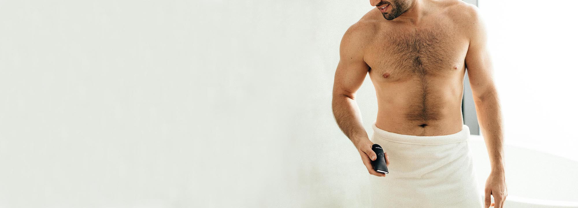 Man on towel holding the meridian trimmer