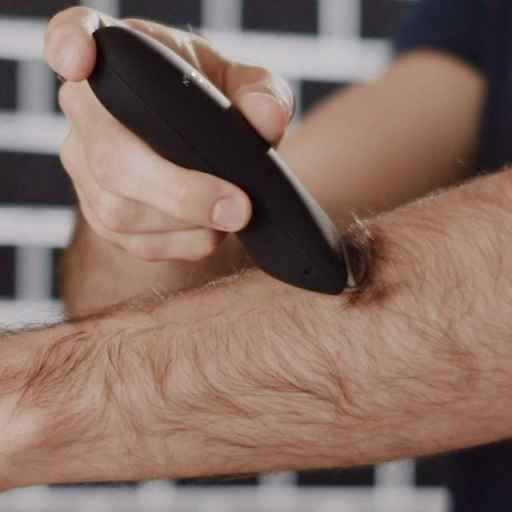 Man shaving the hairs on his arm with the Meridian trimmer