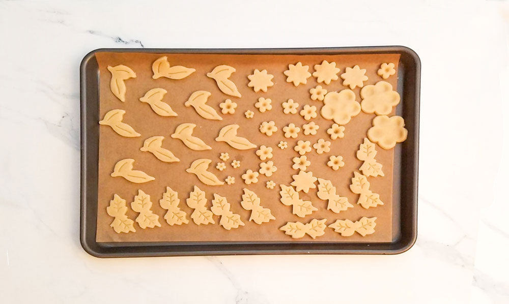 Cut out decorative shapes from the dough.