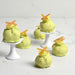 Cream Puffs with Pistachio flavored White Chocolate and Candied Orange Peel Decor