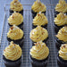 German Buttercream flavored with Viennese Almond Flavor Paste on top of Chocolate Cupcakes
