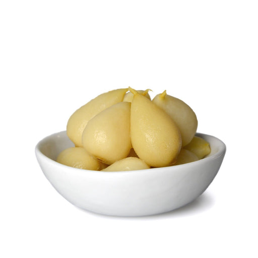 Whole baby pears in syrup in bowl out of packaging