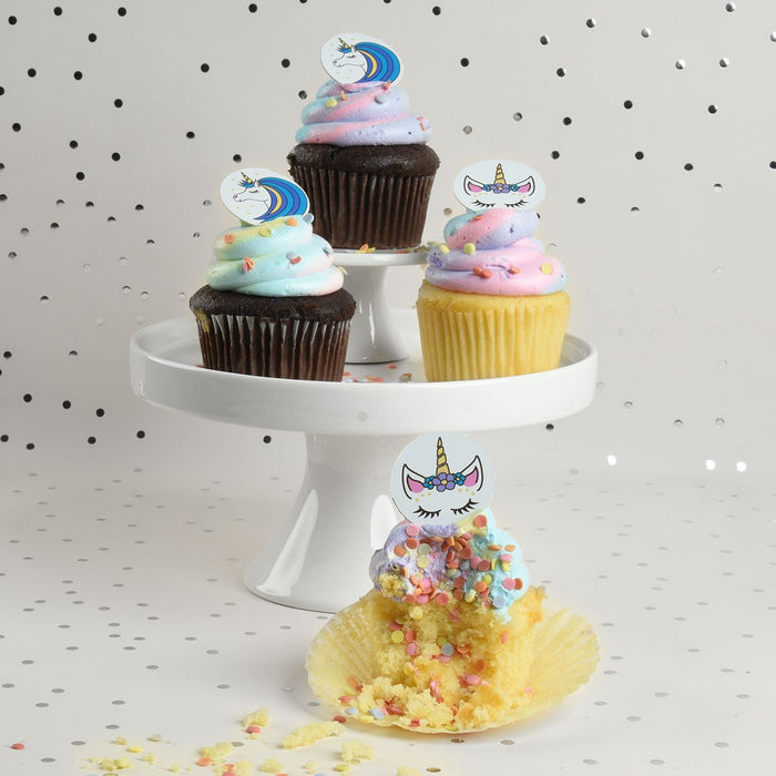 Unicorn chocolate decor on rainbow unicorn cupcakes