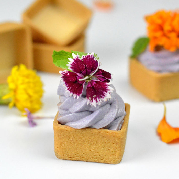Mini square sweet tart filled and decorated with flowers