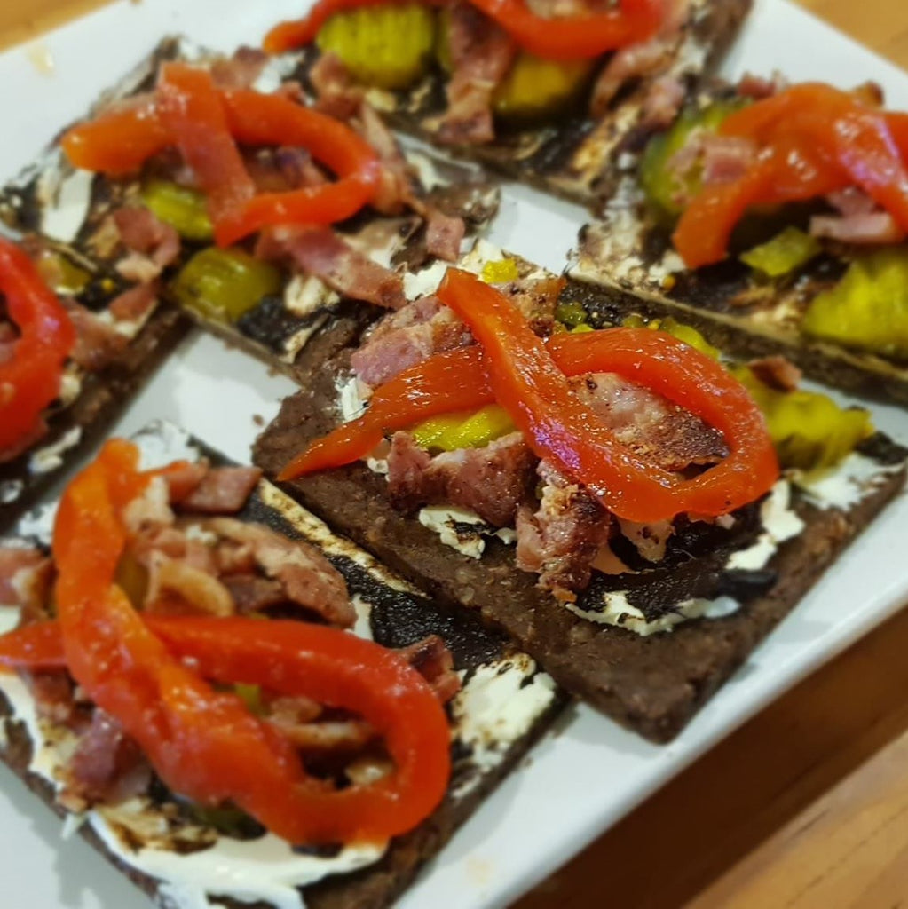 Pumpernickel Bread with Black Garlic Puree and Toppings