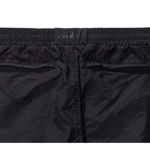 UNDEFEATED PLEATED TRACK PANT