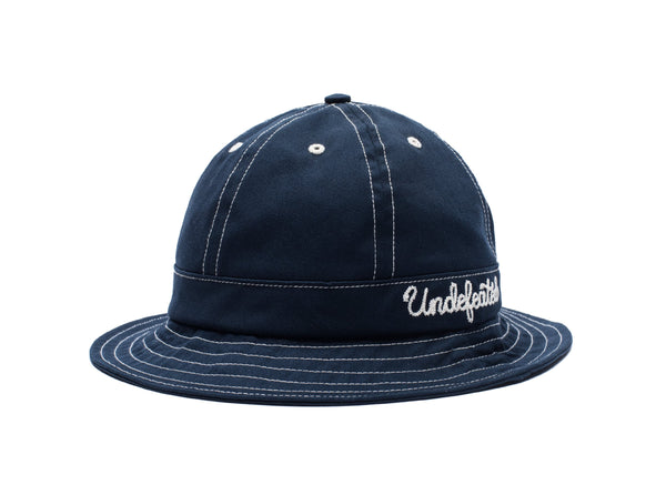 c739060e67b UNDEFEATED BELL BUCKET HAT - NAVY