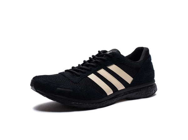 ADIDAS X UNDEFEATED ADIZERO ADIOS - COREBLACK/SUPPLIERCOLOUR