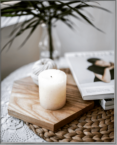 Candle-On-Coaster-Next-To-Magazines-Terra-Collective