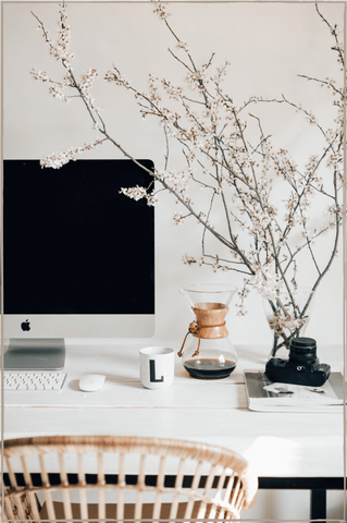 Declutter-For-Wellness-Clean-Desk-With-iMac-Coffee-Glass-Bowl-With-Flowers-Terra-Collective