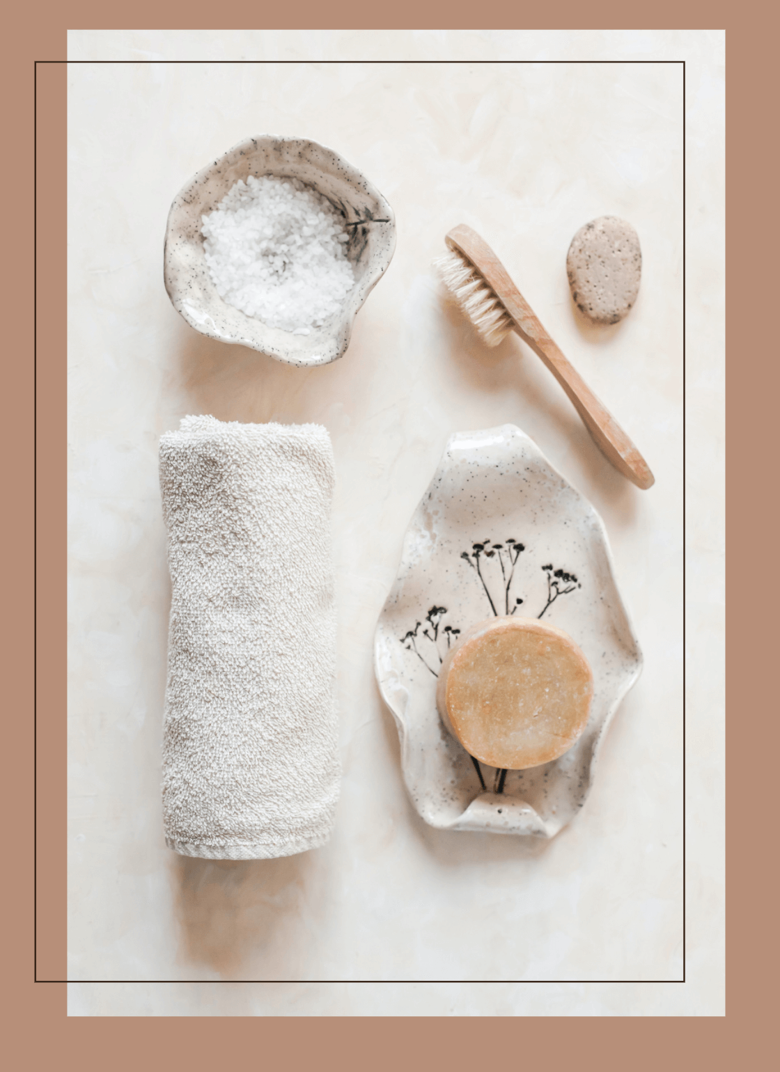 Self-Care-Ritual-Tools-Laying-On-Table-Including-Towel-Dry-Brush-Natural-Soap-Exfoliating-Scrub-And-Pumice-Stone