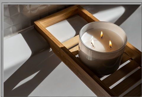 Triple-Wick-Candle-Burning-Next-To-Bath-Terra-Collective