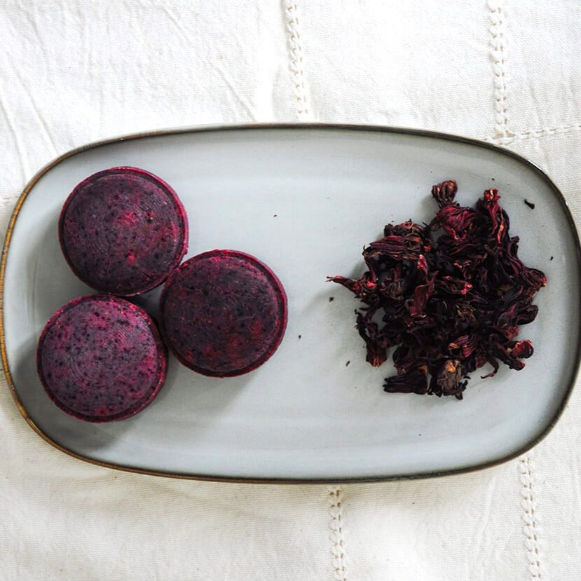 Somi-Hibiscus-Rose-Shampoo-Bar-Lifestyle-Trio-In-Plate-Terra-Collective
