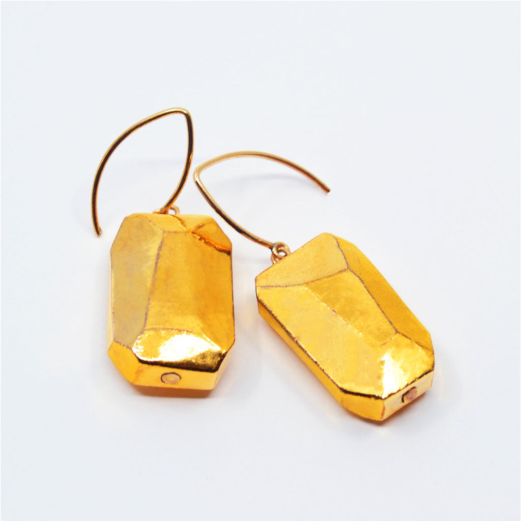 One-of-a-kind porcelain earrings, porcelain beads faceted by hand  with 22 karat gold glaze. 14 karat gold-filled ear wire.