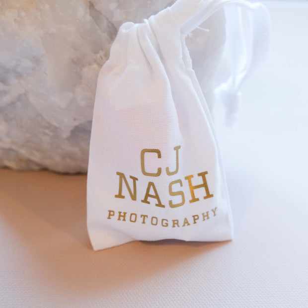 Small White Drawstring Bag with Metallic Logo